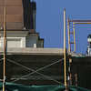 Gloucester: Workers removed the scaffolding around the tower of City Hall Friday morning. Mary Muckenhoupt/Gloucester Daily Times.