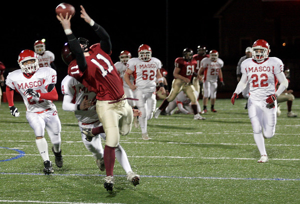 Gloucester's Dylan Maki catches a pass from quarterback Rick Gallant during their during their Division 2A playoff game at Manning Field in Lynn last night. Photo by Kate Glass/Gloucester Daily Times Tuesday, December 2, 2008