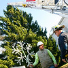Manchester: Rob Lation, owner of R.P. Lations Tree Service talks with Manchester Fire Captain Tod Bigger about their plan to place the snowflake at the top of Manchester's Christmas tree Wednesday afternoon. The official lighting will take place on Sunday. Photo by Kate Glass/Gloucester Daily Times Wednesday, December 3, 2008