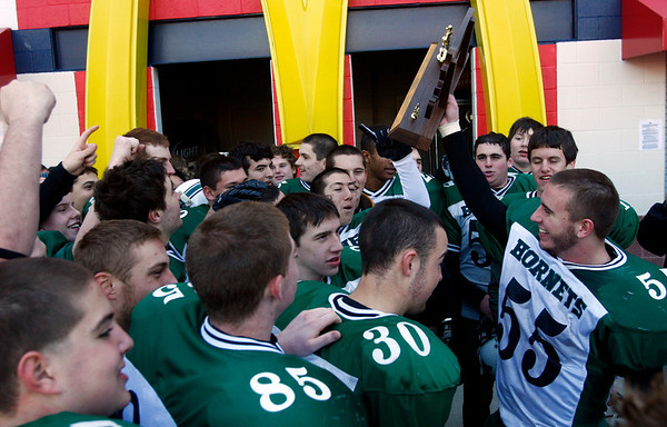 The Manchester Essex hornets hold up their Division 4 Super Bowl trophy after defeating Tri-County 36-6 at Gillette Stadium on Saturday. Photo by Kate Glass/Gloucester Daily Times Saturday, December 6, 2008