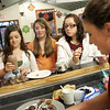 Rockport: From left, Marissa Orlando, 12, Veyla Jackson, 13, and Makayla Hanson, 15, make homemade chocolates with Nikki Klink, the teen director at the YMCA Ben Beyea Youth and Teen Center Wednesday afternoon. Klink thought it was a good time of year to have the kids make easy chocolates such as Oreos and pretzels dipped in chocolate and peanut butter cups and caramel filled chocolates. Mary Muckenhoupt/Gloucester Daily Times