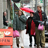 Gloucester: From left, Kacy Lafferty, her sister Sarah Lafferty and her husband Scott Aalbers head down Main Street while doing a little last minute shopping on Main Street Christmas Eve.  Mary Muckenhoupt/Gloucester Daily Times