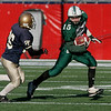 Manchester Essex's Alex Carr runs around Tri-County's Steve Hogan during their Division 4 Super Bowl game at Gillette Stadium on Saturday. Photo by Kate Glass/Gloucester Daily Times Saturday, December 6, 2008