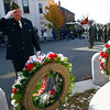 Gloucester: Francis Lander lays a wreath for the American Legion Post 3 at the Joan of Arc statue during Gloucester's Veterans Day ceremony yesterday. Photo by Kate Glass/Gloucester Daily Times Tuesday, November 11, 2008