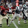 Gloucester's Taylor Burbine looks for an open path as Duxbury's Tyler Genereux and Matt Savard try to block him during the Division 2A Super Bowl at Gillette Stadium on Saturday. The Fishermen lost 46-26. Photo by Kate Glass/Gloucester Daily Times Saturday, December 6, 2008