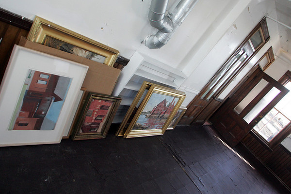 Gloucester:  Piantings wait to be hung in one of the rooms of the Paint Factory. The Ocean Alliance, which purchased the Paint Factory this past summer, will host an art show on the property this weekend.  Mary Muckenhoupt/Gloucester Daily Times