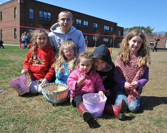DESI SMITH/STAFF Photo    The Castellucci family of Gloucester from left to right, Hope 6, Isaiah 13, Grace 4, Joy 2, Josiah 11, and Faith 8, all sit down together and start in on their just desserts at the Cape Ann Chamber's Annual Easter Egg Hunt Saturday afternoon at the Rockport Elementary School playground, as parents watch and take photos.   April 19,2014.