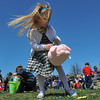 DESI SMITH/STAFF Photo       McKenna Green 5, of Gloucester races to fill her bunny basket full of candy, while her hair get's blown around during the Cape Ann Chamber's Annual Easter Egg Hunt Saturday afternoon at the Rockport Elementary School playground April 19,2014.