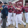 DESI SMITH/Staff photo.  Gloucester's Bart Margiotta is congratulated by his teammates at home plate after hitting a two run homer against Marblehead Friday afternoon at Nate Ross Field at O'maley Field. April 11,2014