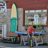DESI SMITH/STAFF Photo     Jeffrey Evans of Surfari on Central Street in Mancester, uses a hand pump Saturday morning  to inflate a new inflatable paddle board that can be rolled up a put into a  backpack that makes it easier to trasport to any location for use.    April 19,2014.