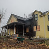 DESI SMITH/STAFF Photo  The day after a fire started around 10:30 p.m. Friday at 10 Cogswell Court.<br />    April 26,2014