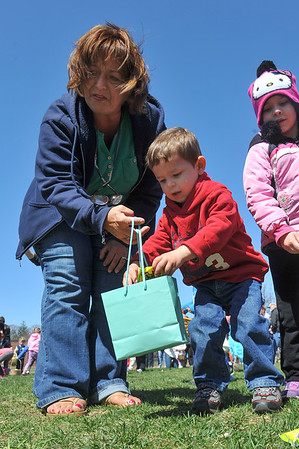 DESI SMITH/STAFF Photo     Ronda Goulart of Gloucester helps her grandson Ryan LaClar 21/2as he gathers up some candy and easter eggs during the Cape Ann Chamber's Annual Easter Egg Hunt Saturday afternoon at the Rockport Elementary School playground April 19,2014.
