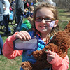 DESI SMITH/STAFF Photo      Lola Colson 6, of Rockport found a silver tickets that let her to choose a big prize, which was the brown bear she holding, during the Cape Ann Chamber's Annual Easter Egg Hunt Saturday afternoon at the Rockport Elementary School playground April 19,2014.