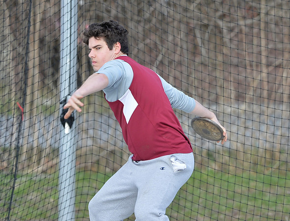 """DESI SMITH/STAFF Photo       Gloucester's Aiden Lyons competes in the Discus throw against Danvers, Thursday afternoon at the New Balance Track and Field at Newell Stadium in Gloucester. Lyons attempt on this throw was for 95' 4"""".  April 17,2014"""