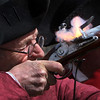 MIKE SPRINGER/Staff photo<br /> Jim Witham of Essex fires a flintlock musket during a Patriot's Day observance Monday morning in Danvers. Witham and other re-enactors of the Danvers Alarm List Company visited 7 memorials around Danvers and Peabody to honor the 7 Danvers colonists who died April 19, 1775 at the Battle of Lexington.