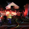 James Niedzinski/Staff photo<br /> The home at 10 Cogswell Court, built in 1870, was badly damaged by fire Friday night in Essex.
