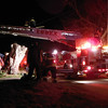 James Niedzinski/Staff photo<br /> A firefighter suffered non-lifethreatening injuries when he fall off the ladder of ladder truck at the scene of a fire in Essex late Friday night.