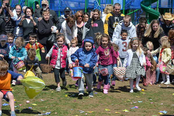 """DESI SMITH/STAFF Photo      """"And Their Off""""  children take off at the Cape Ann Chamber's Annual Easter Egg Hunt Saturday afternoon at the Rockport Elementary School playground, as parents watch and take photos.   April 19,2014."""