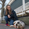 DESI SMITH/STAFF Photo  Sarah Rick of Rockport gives her 12 year old basset hound Duchess a belly rub, as they rested while out for a walk Saturday morning on Main St in Rockport. April 12,2014