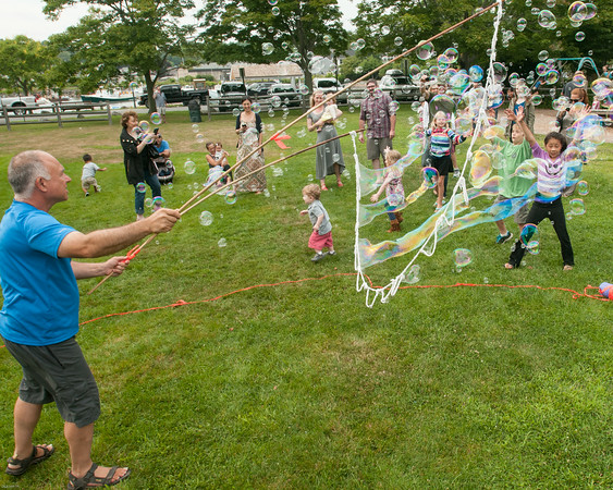 "DESI SMITH/Staff photo.    James Dichter the ""Bubbleguy""  was a big hit for the kids as he created small to very large bubbles at Manchester's celebration of the arts Saturday afternoon at Masconomo Park.    August 2,2014"