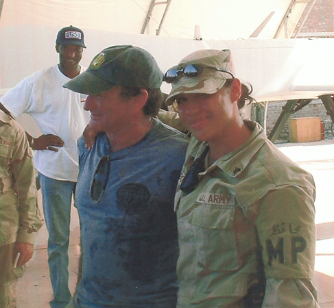 Courtesy photo<br /> Then Army Sgt. Jenny Gibbons, who grew up in Gloucester and now lives in the Merrimack Valley, stands with late comedian and actor Robin Williams in Pakistan in 2002.  Williams was visiting doing standup comedy while Gibbons served as a Military Police officer.