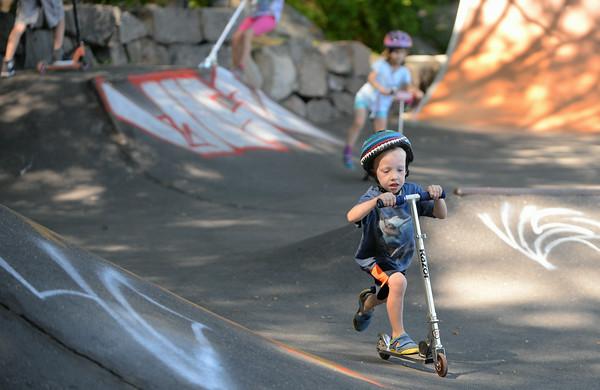 RYAN HUTTON/ Staff photo.<br /> Will DeFort, 4, picks up speed at the skate park behind the Ben Beyea Youth & Teen Center.