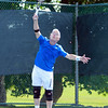 Ed Frick leaps in the air while smashing a serve during the Bass Rocks Men's Member/Guest Tournament A-Flight players match on Saturday morning. DAVID LE/Staff  photo. 8/16/14.