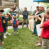 DESI SMITH/Staff photo.   Ollie Benson 12, (right) takes a photo of his brother Ted 9, with a snake as John Gallagher of Cape Ann Vernal Pond Team looks on, at Manchester's celebration of the arts Saturday afternoon at the Public Library.    August 2,2014