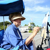 Donna Jenko, of Rockport, sits in the shade of her chair while painting next to Periwinkles on Main Street in Essex on Saturday morning. Local artists painted scenes of Essex on Saturday and the paintings will be auctioned off on Sunday during the 3rd Annual En Plein Air Painting and Wet Paint Auction, sponsored by the Essex Merchants Group. DAVID LE/Staff  photo. 8/16/14.