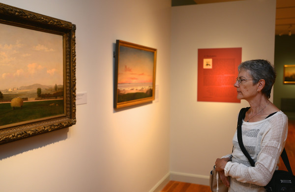 RYAN HUTTON/ Staff photo.<br /> Mary Kniaz, of Hokinton, admires some of the paintings of Fritz Henry Lane at the newly reopened Cape Ann Museum.