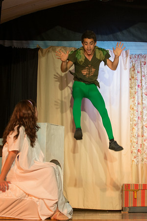 DESI SMITH/Staff photo. Sofia Gadbois  (Wendy Darling) looks on as Elliot Davis (Peter Pan) leaps with excitment in a scene from Adventures of Peter Pan, at a final dress rehearsal Thursday night at the Annisquam Village Hall on Leonard Street. The show opens next Tuesday and runs through Sunday.  July 31,2014
