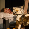 DESI SMITH/Staff photo.  Charlie Rousmaniere who plays Michael Darling, lays sleeping,and wakes to a magical world, at a final dress rehearsal Thursday night at the Annisquam Village Hall on Leonard Street. The show opens next Tuesday and runs through Sunday.  July 31,2014