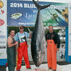 DESI SMITH/Staff photo.   From left to right, Dan Reddy,Captain Anthony Caturano of the Tonno out of Gloucester, and Captain Mark Kooskal pose with a 588 lb Blue Fin at the Cape Ann Marina Sunday afternoon at the 3rd Annual Bluefin Blowout Tuna Tournament. It was the biggest catch of the Day on Sunday, out of the two day event.  August 2,2014
