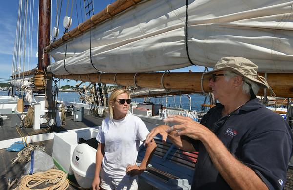 RYAN HUTTON/ Staff photo.<br /> John Fuller, executive director of Schooner Adventure, talks with First Mate Barb Krasinski on deck of Adventure.