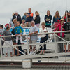 DESI SMITH/Staff photo.   Spectators line the ramps at the Cape Ann Marina  Sunday afternoon on the second day of the 3rd Annual Bluefin Blowout Tuna Tournament.   August 2,2014