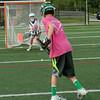 DESI SMITH/Staff photo.  Logan Carroll 13,puts a shot on net, as he and others go through some lacross drills at a Lacross camp held Wednesday afternoon at Hyland Field, at Manchester Essex Regional High School.   August 6,2014