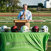 DESI SMITH/Staff photo.   Chuck Huggins president of Xenith, who helped design the new XZE varsity helmet, talks about it's features like the air shell shock absorbers, giving the players safety and comfort,Thursday afternoon at the Gloucester High School for Concussion Awareness.  August 14,2014
