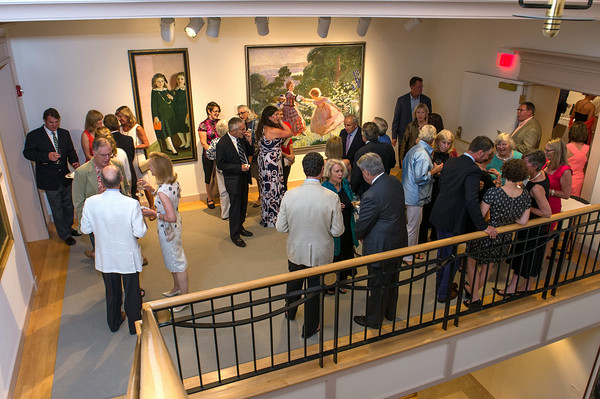DESI SMITH/Staff photo.   Guest mingle on the second floor balcony during a gala celebration at the re-opening of the Cape Ann Museum saturday night, after a 10-month renovation that reconfigured and opened up a number of the galleries, as well as upgrading the electrical, hvac and security systems to modern code.  August 16,2014