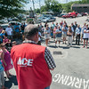 DESI SMITH/Staff photo.   Jay Smith of Smith of Ace Hardware and Lumber at Station Square in Rockport, greets a large crowd of family and friends friday afternoon, who stopped by to support Jeff Dietrich (over his left shoulder) a 54-year-old building contractor and lifelong resident of Rockport, who was diagnosed with ALS just over a year ago. The ALS challenge that was set up in his honor to raise money and awareness for ALS.    August 15,2014