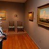 RYAN HUTTON/ Staff photo.<br /> Anna Andella, of Gloucester, admires some of the paintings of Fritz Henry Lane at the newly reopened Cape Ann Museum.