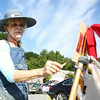 Lynn Murray, of Salem, delicately adds color to her painting of a scene along the Essex River on Saturday morning. Local artists painted scenes of Essex on Saturday and the paintings will be auctioned off on Sunday during the 3rd Annual En Plein Air Painting and Wet Paint Auction, sponsored by the Essex Merchants Group. DAVID LE/Staff  photo. 8/16/14.