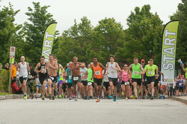 DESI SMITH/Staff photo.   Runners take off in the Triple Threat 1 mile Sunday morning at Rockport Elementry School on Jerdens Lane.    August 3,2014