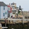 PAUL BILODEAU/Staff photo. People taking in the beautiful scenery in Rockport Harbor during a quite Summer day recently.