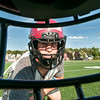 DESI SMITH/Staff photo.  Senior Captain Jason Erwin, fitted with his new XZE varsity helmet, is ready for action at Gloucester High School Thursday afternoon for concussion awareness.  August 14,2014