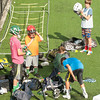 DESI SMITH/Staff photo.  Young players put some protective gear on before heading out to perform some lacross drills at a Lacross camp held Wednesday afternoon at Hyland Field, at Manchester Essex Regional High School.   August 6,2014