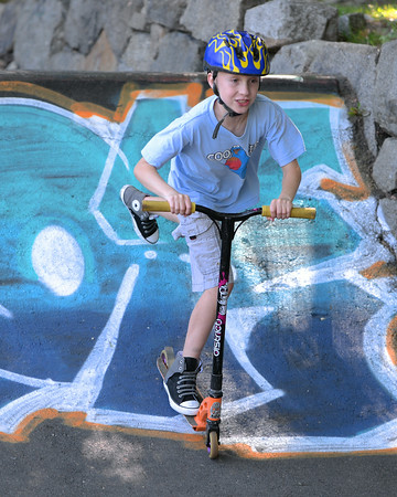 RYAN HUTTON/ Staff photo.<br /> Ruen DeFort, 9, drops in on a scooter at the skate park behind the Ben Beyea Youth & Teen Center.