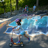 RYAN HUTTON/ Staff photo.<br /> Gretel Marshall, 5, scoots downhill at the skate park behind the Ben Beyea Youth & Teen Center.