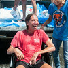 DESI SMITH/Staff photo.   Jeffrey Dietrich and his wife Cher, are all smiles and wet after they took the ALS challenge together, that was set up in is honor to raise money and awareness,Friday afternoon at Smith Ace Hardware and Lumber at Station Square. Dietrich  a 54-year-old lifelong resident of Rockport, and building contractor,was diagnosed with ALS just over a year ago.   August 15,2014