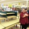 AMY SWEENEY/Staff photo. Faith LeBrun, of Gloucester and Kyle Edmonds, both part-time employees at Market Basket, were told that as of Sunday they would not be scheduled to work because of the lack of business at the store. 8.07.14