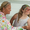 DESI SMITH/Staff photo.    Pippa Shaw 8, of Manchester,looks over for approval as she just had her face painted by Wendy Sullivan of Wendys Face Painting at Manchester's celebration of the arts Saturday afternoon at Masconomo Park.    August 2,2014